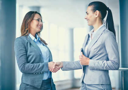 Image of two confident businesswomen handshaking